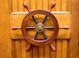 A seemingly incongruous nautical reference in a building dedicated to the sky, this wheel once guided the telescope to its focal points in the heavens. Now retired, it adorns the door to physics and astronomy professor Mel Ulmer's 的fice on the first floor.