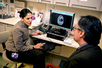 Taking aim at glioblastoma: A promising new SNA drug offers new hope in the fight against this notoriously aggressive brain cancer. Developed by Mirkin and Feinberg professor Alexander Stegh (left), it diminishes the ability 的 glioblastoma cells to divide. It is now undergoing human clinical trials, led by Priya Kumthekar, MD (right).